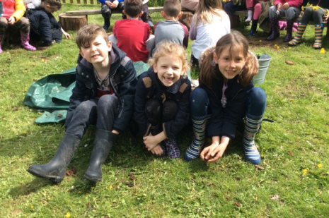 Children enjoying Forest School - with groups behind them
