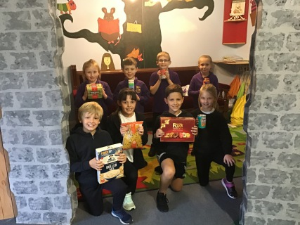 Some of the pupils from Year 3 and Year 4 with Harvest donations