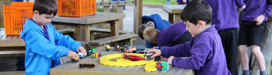 Image showing children playing with a train set